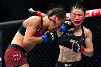Бонусы турнира UFC 248: Исраэль Адесанья - Йоэль Ромеро, Йоанна Енджейчик - Вейли Жанг